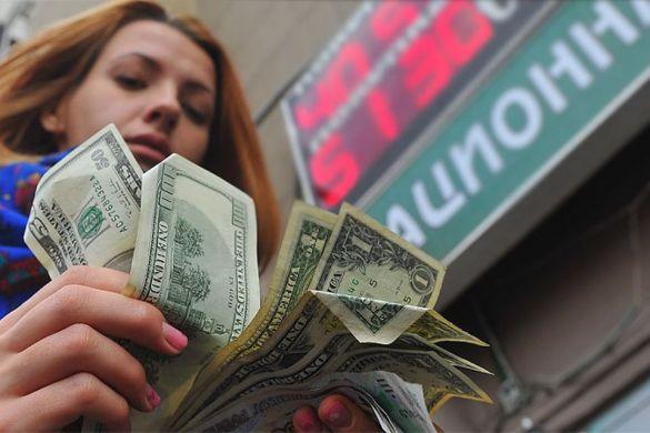 Эксперт Левченко сообщил, что в 2022 году доллар будет стоить 100 рублей